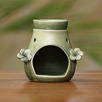 Ceramic oil warmer, 'Frangipani Dreams' - Handcrafted Green Floral Ceramic Oil Warmer from Bali