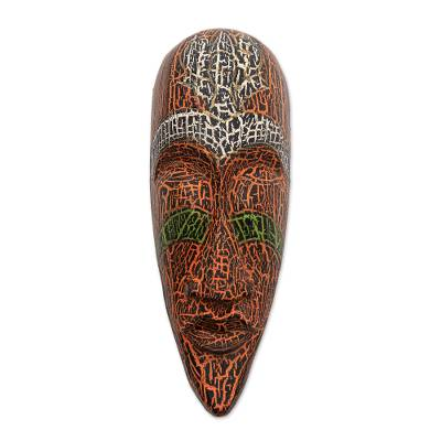 Unique Brown and White Painted Albesia Wood Mask from Bali