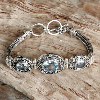 Blue topaz pendant bracelet, Tradition