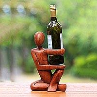 Wood wine bottle holder, 'The Invitation' - Hand Carved Wood Wine Bottle Holder