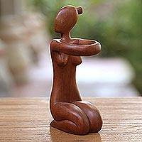 Wood wine bottle holder, 'The Offering' - Hand Carved Suar Wood Wine Bottle Holder