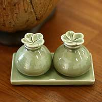 Ceramic oil bottles, 'Jade Bali Frangipani' - Ceramic Bottle Set