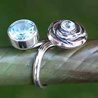 Blue topaz wrap ring, 'The Rose' - Sterling Silver and Blue Topaz Floral Wrap Ring from Bali