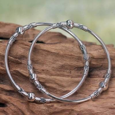 Sterling silver bangle bracelets, 'Ubud Moons' (pair) - Sterling Silver Bangle Bracelets from Indonesia (Pair)