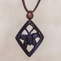 Coconut shell pendant necklace, 'Butterfly Muse' - Coconut shell pendant necklace