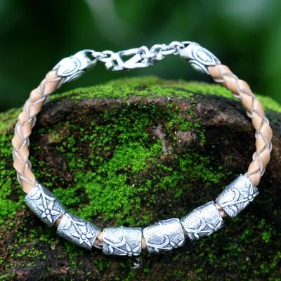 Leather braided bracelet, 'Daisy Dreams' - Silver and Braided Leather Bracelet from Indonesia