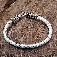 Leather braided bracelet, 'Midwinter Joy' - Sterling Silver and Braided Leather Bracelet