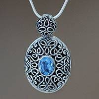 Blue topaz pendant necklace, 'Jakarta Smile' - Blue topaz pendant necklace