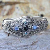 Onyx and moonstone cuff bracelet, 'Radiant Bali' - Moonstone and Onyx Silver Cuff Bracelet