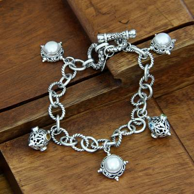 Cultured pearl charm bracelet, 'Moon Echo' - Handcrafted Sterling Silver and Pearl Charm Bracelet