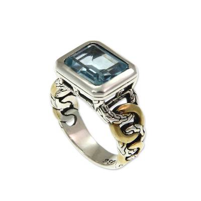 Gold accent blue topaz solitaire ring
