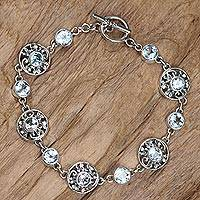 Blue topaz flower bracelet, 'Frangipani Glam'
