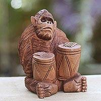 Wood statuette, 'Orangutan Plays the Jambe' - Handcrafted Wood Sculpture from Bali