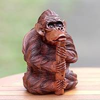 Wood statuette, 'Orangutan Plays the Flute' - Handcrafted Wood Sculpture from Bali