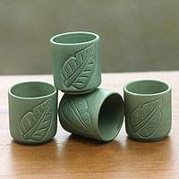 Ceramic cups, 'Bay Leaf' (set of 4) - Green Tea Cups with Leaf Motifs (Set of 4)
