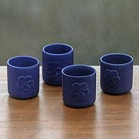 Ceramic cups, 'Blue Frangipani' (set of 4) - Blue Tea Cups with Leaf Motifs (Set of 4)