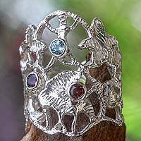 Amethyst and garnet band ring, 'Baroque Bali' - Wide Sterling Silver Ring with Amethyst Garnet and Topaz