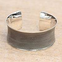 Sterling silver cuff bracelet, 'Infinity Braid' - Wide Concave Silver Cuff Bracelet