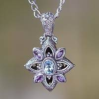 Amethyst and blue topaz flower necklace, 'Jasmine Shield' - Floral Sterling Silver Necklace with Amethyst and Blue Topaz