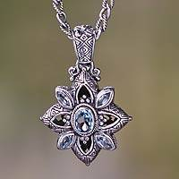 Blue topaz flower necklace, 'Jasmine Shield' - Floral Sterling Silver Necklace with Blue Topaz 2.5 cts