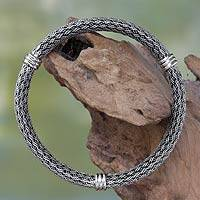 Sterling silver bracelet, 'Serpent Wisdom' - Balinese Braided Sterling Silver Bangle
