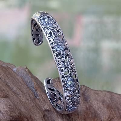 Blue topaz cuff bracelet, 'Dancing Swans' - Blue Topaz and Sterling Silver Cuff Bracelet from Bali