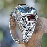 Blue topaz and garnet cocktail ring, 'Limpid Pool' - Blue Topaz and Garnet Silver Cocktail Ring from Bali