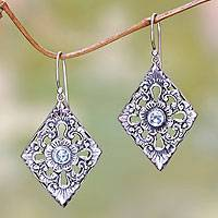 Blue topaz dangle earrings, 'Blue Padma' - Sterling Silver and Blue Topaz Earrings with Floral Motif