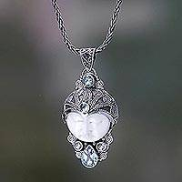 Blue topaz and bone pendant necklace, 'Dayang Sumbi' - Carved Bone and Blue Topaz Silver Pendant Necklace
