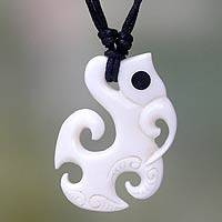 Bone pendant necklace, 'Ancient Fish' - Fair Trade Carved Cow Bone Pendant Necklace
