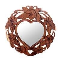 Wool wall mirror, 'Frangipani Heart' - Heart-Shaped Wood Wall Mirror with Floral Motif