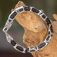 Men's leather and sterling silver bracelet, 'Bone Dragon' - Sterling Silver and Braided Black Leather Men's Bracelet
