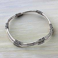 Sterling silver bangle bracelets, 'Elements of Life' (pair) - Balinese Handcrafted Sterling Silver Bangle Bracelets (Pair)