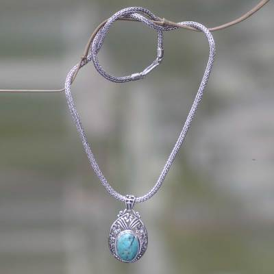 Sterling silver flower necklace, 'Frangipani Halo' - Sterling Silver Necklace with Turquoise Color Gem