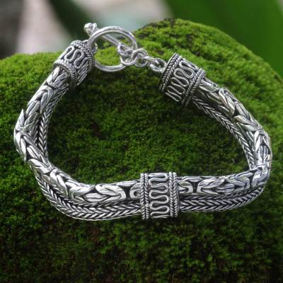 Sterling silver braided bracelet, 'Dragon Queen' - Sterling Silver Naga and Borobudur Braided Bracelet