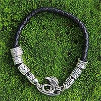 Braided leather bracelet, 'Angel of Nature in Black' - Black Braided Leather Bracelet with Sterling Silver Pendants