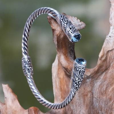 Blue topaz cuff bracelet, 'Beacon of Light' - Blue Topaz on Sterling Silver Hinged Cuff Bracelet from Bali