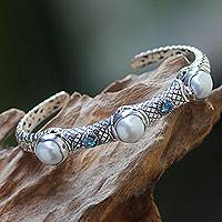 Cultured pearl and blue topaz cuff bracelet, 'Three Moons' - Pearl Sterling Silver Hinged Cuff Bracelet with Blue Topaz
