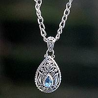 Blue topaz pendant necklace, 'Padma Lotus' - Artisan Crafted Floral Silver Necklace with Blue Topaz