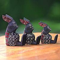 Wood batik figurines, 'Nibbling Rabbits' (set of 3) - Wood Batik Rabbit Family Figurine Sculptures (Set of 3)