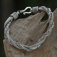 Sterling silver braided bracelet, 'Sanca Batik' - Handcrafted Triple Braid Sterling Silver Bracelet from Bali