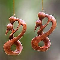 Wood ornaments, 'Sealed with a Kiss' (pair) - Set of 2 Artisan Crafted Romantic Wood Ornaments