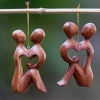 Wood ornaments, 'Look Into My Eyes' (pair) - 2 Heart Shaped Romantic Ornaments Hand Carved Wood Sculpture