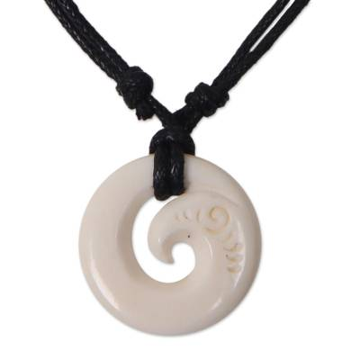 Bone pendant necklace, 'Bali Spiral' - Abstract Spiral Bone Pendant Hand Crafted Cotton Necklace
