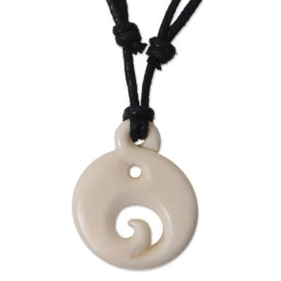 Bone pendant necklace, 'Moonlit Wave' - Hand Carved Bone Pendant on Cotton Necklace from Bali