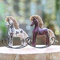 Wood statuettes, 'Jaran Goyang I' (pair) - Antiqued Rocking Horse Statuettes in Hand Carved Wood (Pair)