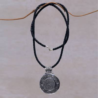 Sterling silver and leather pendant necklace, 'Circular Visions' - Artisan Crafted Necklace Sterling Silver on Leather