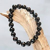 Onyx beaded stretch bracelet, 'Black Lava' - Stretch Bracelet from Bali with Faceted Round Onyx Beads