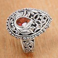 Garnet cocktail ring, 'Lotus Spirit' - Pear Shaped Sterling Silver Cocktail Ring with Garnet
