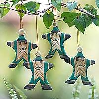 Wood ornaments, 'Happy Green Santa' (set of 4) - 4 Hand Carved Wood Christmas Ornaments with Santa Theme